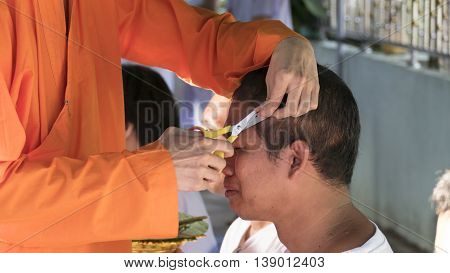 Monk Cut Hair Of Man Who Will Become Buddhism Monk In Ordination Ceremony