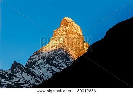 Golden sunlight shine on Matterhorn mountain peak Zermatt Switzerland
