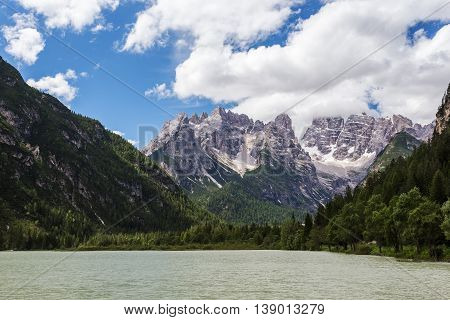 Beautiful summer mountain landscape with lake in foreground. Lake Landro in Dolomites Alps Italy
