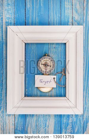 Sign Target And Compass In A White Frame - Vintage Style