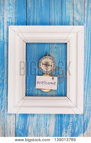 Sign Welcome And Compass In A White Frame - Vintage Style