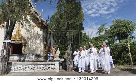 Man Who Will Become Buddhism Monk Praying And Walking Around Church With Their Relatives In Processi