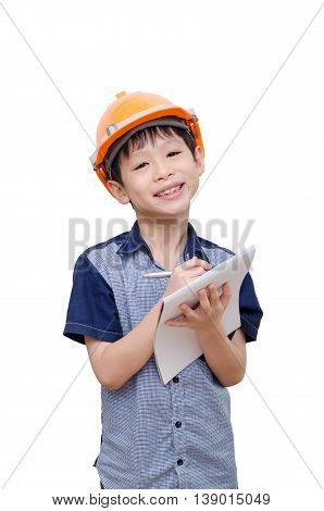 Asian boy with helmet writing on notebook over white