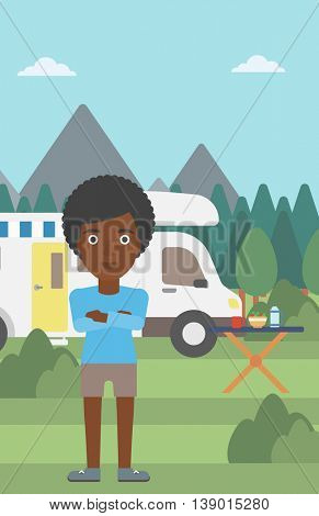 An african-american woman standing in front of motor home. Woman with arms crossed enjoying vacation in camper van. Woman travelling by camper van. Vector flat design illustration. Vertical layout.
