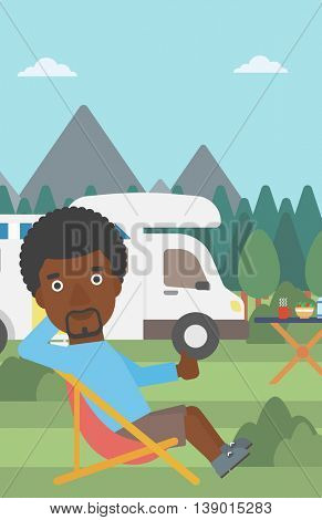 An african-american man sitting in a folding chair and giving thumb up on the background of camper van. Man enjoying vacation in camper van. Vector flat design illustration. Vertical layout.