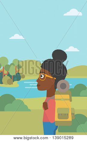 An african-american woman with backpack enjoying the view of landscape with mountains and lake. Vector flat design illustration. Vertical layout.