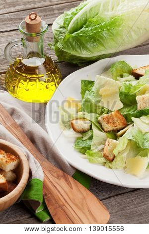 Fresh healthy caesar salad on wooden table