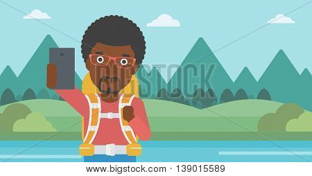 An african-american man making selfie on the background of mountains. Man with backpack taking photo with cellphone. Vector flat design illustration. Horizontal layout.