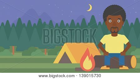 African-american travelling man sitting on a log near a fire on a background of camping site with tent. Man sitting near a campfire at a campsite. Vector flat design illustration. Horizontal layout.