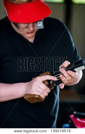 Woman Pulling Pistol On Sport Shooting Training