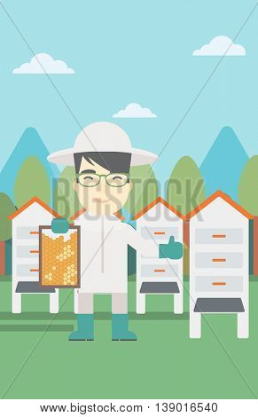 An asian farmer wearing protective suit. Bee-keeper holding a framework in hand and showing thumb up on the background of apiary. Vector flat design illustration. Vertical layout.