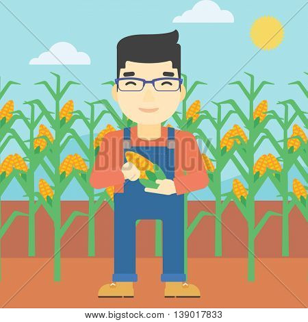 An asian farmer holding a corn cob. Young farmer standing on the background of corn field. Vector flat design illustration. Square layout.