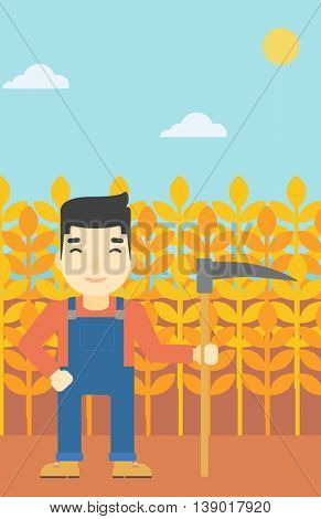 An asian farmer holding a scythe. Young farmer standing on the background of wheat field. Vector flat design illustration. Vertical layout.