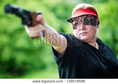 Sport shooting woman, selective focus, horizontal image
