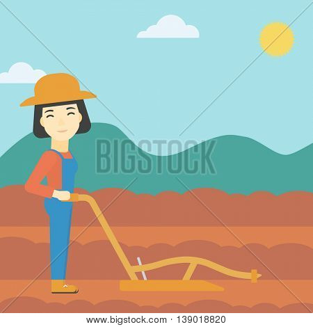 An asian female farmer using a plough on the background of plowed agricultural field. Farmer working with a plough. Vector flat design illustration. Square layout.