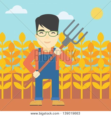 An asian smiling farmer holding a pitchfork. Farmer standing on the background of wheat field. Vector flat design illustration. Square layout.