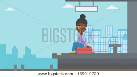 African-american woman sitting on a suitcase at the train station on the background of arriving train. Woman waiting for a train at the platform. Vector flat design illustration. Horizontal layout.