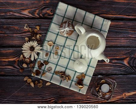 Beautiful still life with white teapot and cookies