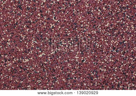 Background - a wall of red marble crumb.