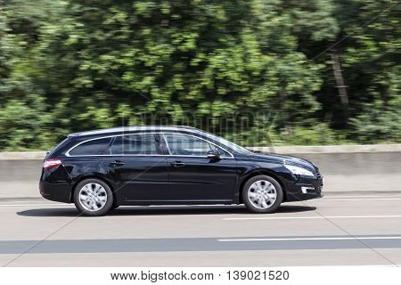 FRANKFURT GERMANY - JULY 12 2016: Peugeot 508 SW Estate large family car on the highway in Germany