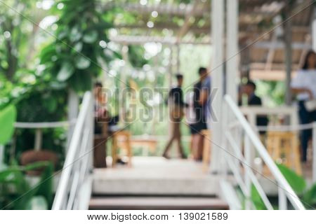 Blurred background - Coffee shop in garden blur background with bokeh. Vintage filtered image.