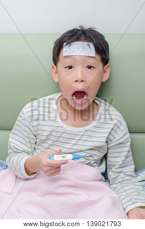 Young Asian boy feel exciting after looking at thermometer