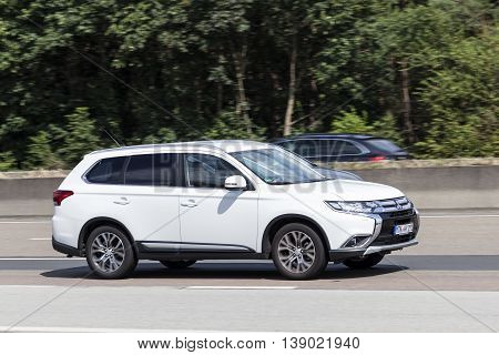 FRANKFURT GERMANY - JULY 12 2016: Third generation Mitsubishi Outlander on the highway in Germany