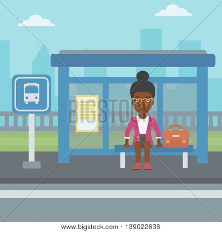 An african-american woman with briefcase waiting for a bus at a bus stop on a city background. Young woman sitting at bus stop at the city street. Vector flat design illustration. Square layout.