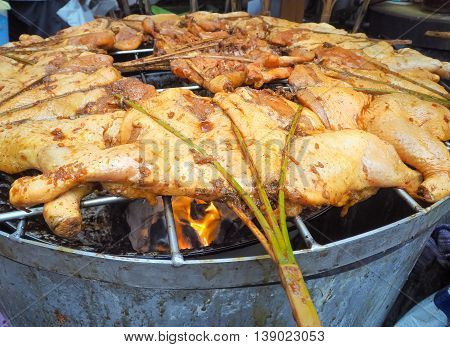 Chicken grilled on over charcoal, Thai food