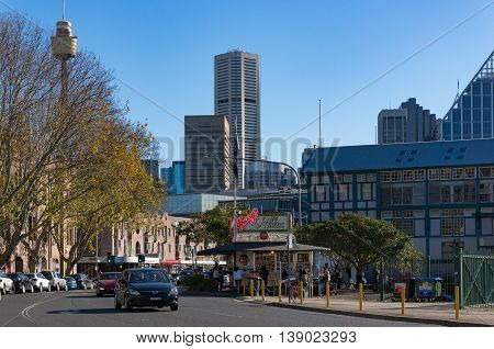 Sydney Australia - Jul 03 2016: Cowper Wharf road with city views and famous Harry's Cafe De Wheels. Woolloomooloo NSW