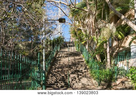 Sydney Australia - Jul 03 2016: Famous McElhone Stairs connecting Potts Point suburb with Woolloomooloo and CBD. The stairs are a key thoroughfare for residents to access the city