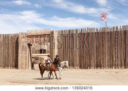 TABERNAS SPAIN - OCT 17 2015: Two cowboys at the Fort Bravo western style theme park in the Province of Almeria Spain