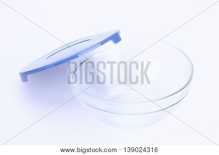 glass food container with blue plastic lid isolated on white background.
