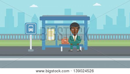 An african-american young man waiting for a bus at a bus stop on a city background. Young man sitting at the bus stop. Vector flat design illustration. Horizontal  layout.