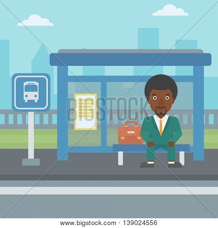 An african-american young man waiting for a bus at a bus stop on a city background. Young man sitting at the bus stop. Vector flat design illustration. Square layout.