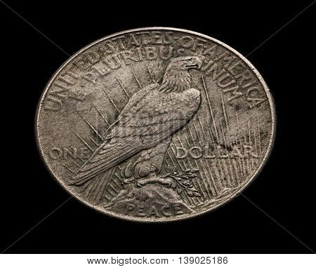 American silver dollar with eagle isolated on black angle shot macro
