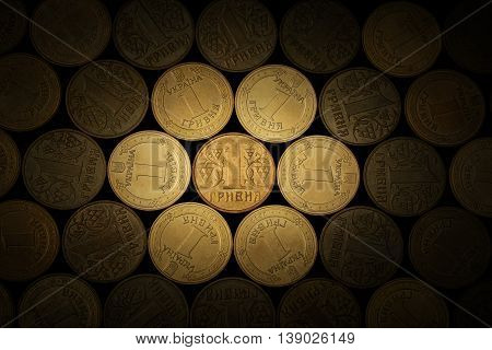 Ukrainian hryvnia coins on a black background