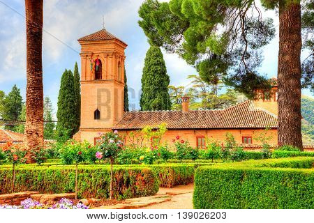 Beautiful historical monument architecture surrounded by fresh garden in Granada, Alhambra - Spain