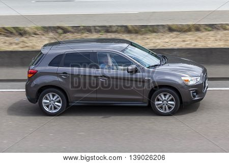 FRANKFURT GERMANY - JULY 12 2016: Mitsubishi ASX or Outlander Sport on the highway in Germany