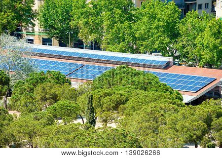 Blue solar cells panels on the house roof. Green energy technology