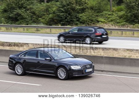 FRANKFURT GERMANY - JULY 12 2016: Black Audi A8 Quattro luxury sedan on the highway in Germany