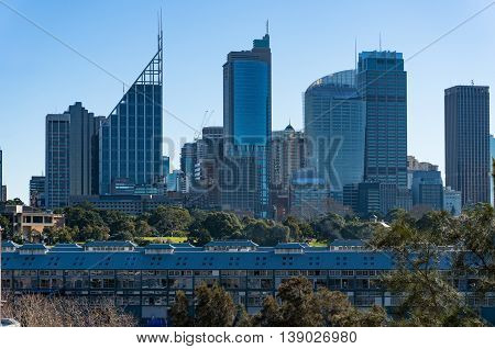 Fingers wharf with Sydney Central Business District skyline skyscrapers on sunny day
