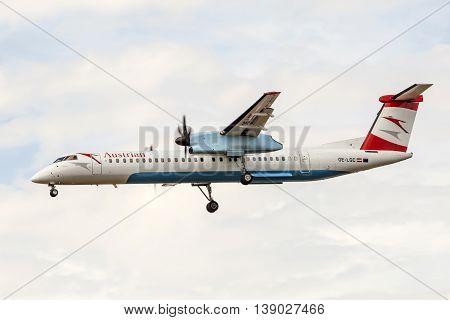 FRANKFURT GERMANY - JULY 12 2016: Austrian Airlines Bombardier Dash 8 landing at the Frankfurt Main international airport