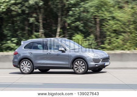 FRANKFURT GERMANY - JULY 12 2016: Porsche Cayenne SUV on the highway in Germany