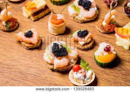 Exquisite selection of luxury canapes appetizer ready to be served for events celebrations or other occasion