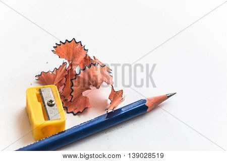 Pencil And Pencil Sharperner On White Background