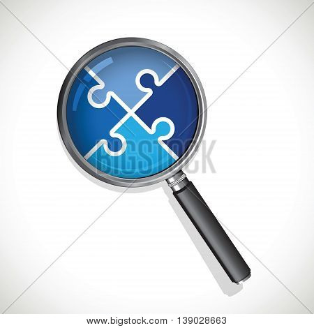 a magnifying glass on a blue jigsaw