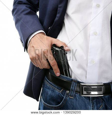 Man with gun tucked in pants isolated on white