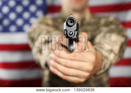Man with gun on star and stripes background