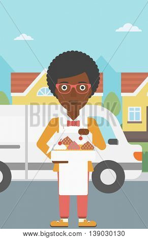 An african-american female baker holding a box of cakes. A baker delivering cakes. Baker with cupcakes standing on the background of delivery truck. Vector flat design illustration. Vertical layout.